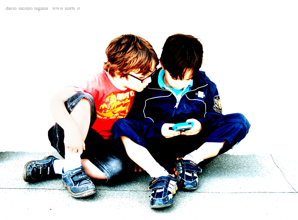 Two Boys Playing with Information